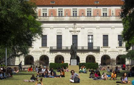 Students studying on the South Mall with tower in background