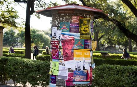 Fliers on kiosk